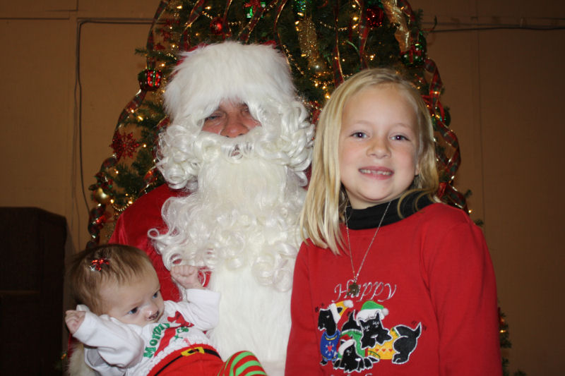 Children Give their Wishes to Santa